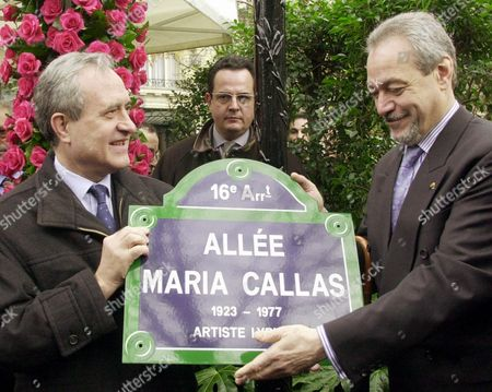 TIBERI CLIS Paris Mayor Jean Tiberi, left, hands a Maria Callas Way street sign to Greek Ambassador to France Elias Clis during the Maria Callas Alley inauguration in Paris . Tiberi on Friday officially renamed a small street for renowned diva Maria Callas, who died in the French capital in 1977 after spending her last years alone and disconsolate. Man at center is unidentified
