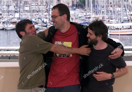 "MOLL LOPEZ LUCAS French director Dominik Moll, center, jokes with his actors Sergi Lopez of Spain, left, and Laurent Lucas of France, right, during a photocall for their film "" Harry, he is here to help"" in competition for the Golden Palm at the 53rd International Film Festival in Cannes, French Riviera"