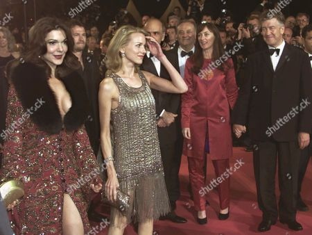 """LYNCH WATTS HARRING American actress Laura Elena Harring, left, and British born actress Naomi Watts pose for photographers while their American director David Lynch and his wife Mary Sweeney look on as they arrive at the festival palace to attend the screening of """"Mulholland Drive"""" in Cannes, France, . """"Mulholland Drive"""" is in competition at the 54th International Film Festival"""