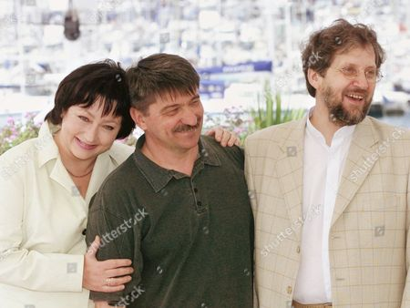 "SOKUROV KOUZNETSOVA MOZGOVOI Russian director Alexander Sokurov, center, poses with actors Maria Kouznetsova and Leonid Mozgovoi, right, during a photocall at the festival palace in Cannes, France, . Kouznetsova and Mozgovoi star in ""Taurus"" directed by Sokurov which will be screened Thursday in competition at the 54th Cannes Film Festival"