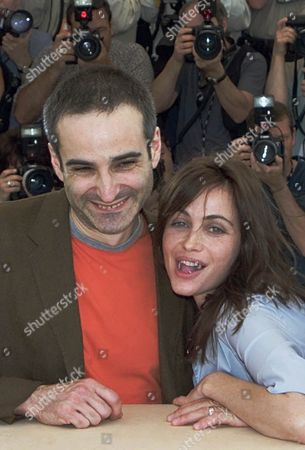 "BEART ASSAYAS French actress Emanuelle Beart, right, jokes as she poses with French director Olivier Assayas, left, during a photocall for their film ""Les Destinees Sentimentales"", in competition for the Golden Palm, at the Film Festival in Cannes, France"