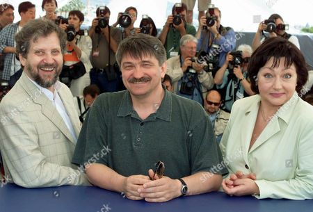 "SOKUROV MOZGOVOI KOUZNETSOVA Russian director Alexander Sokurov, center, Russian actor Leonid Mozgovoi, left, and Russian actress Maria Kouznetsova, right, smile during a photocall for their film ""Taurus,"" which is in competition, at the Cannes Film Festival in Cannes, France"