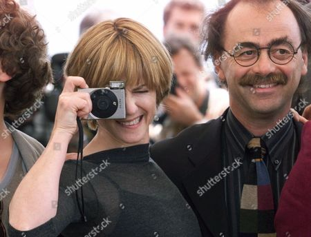 HUNTER NICHETTI American actress Holly Hunter snaps a photo while Italian actor Maurizio Nichetti stands next to her during the photocall of the jury at the 52nd Cannes Film Festival, in Cannes, France
