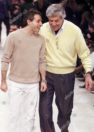Stock Image of CERRUTI SPELIOPOULOS American-Greek designer Peter Speliopoulos, left, and Nino Cerruti talk on the catwalk after their fall-winter ready-to-wear fashion show presentation in Paris