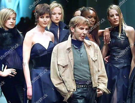 MONTANA French designer Claude Montana, center, surrounded by models, acknowledges applause after his Fall-Winter ready-to-wear 2001 fashion show presentation in Paris