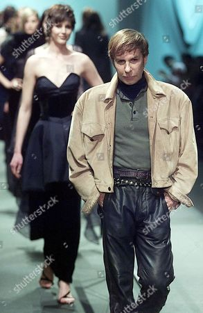 Stock Picture of MONTANA French designer Claude Montana, right, followed by models, acknowledges applause after his Fall-Winter ready-to-wear 2001 fashion show presentation in Paris