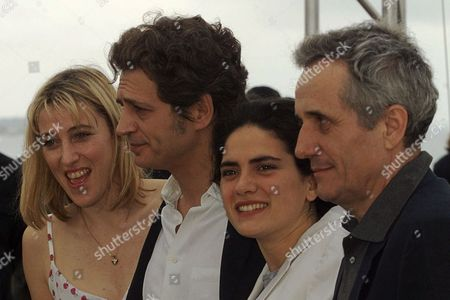 """Stock Image of BELLOCHIO French actress Valeria Bruni, left, Italian actor Fabrizio Bentivoglio, 2nd left, Italian actress Maya Sansa, 2nd right, and Italian director Marco Bellochio, right, pose for photoraphers during a photocall for the film""""the Wet-Nurse""""(la Balia), in competition, at the 52nd Cannes Film Festival in Cannes, France"""