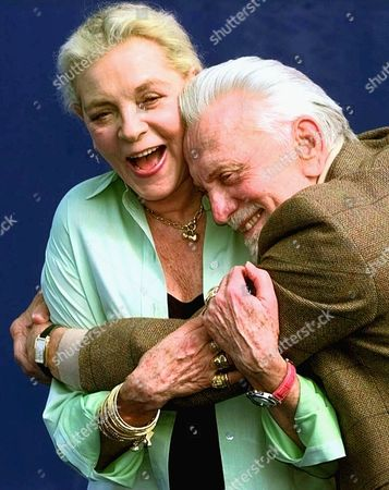 "BACALL DOUGLAS American movie stars Lauren Bacall and Kirk Douglas hug during a photocall to promote their movie ""Diamonds"" by U.S. director John Asher to be screened at the American Film Festival in Deauville, Normandy, France"
