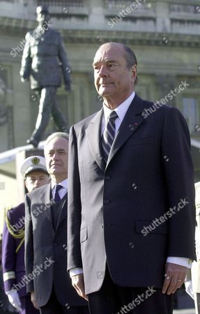 CHIRAC TIBERI French President Jacques Chirac, right, and Paris Mayor Jean Tiberi, second left, salute the French colors, on the Champs Elysees avenue in Paris after the unveiling of the first statue of French General de Gaulle, 30 years to the day after the General's death