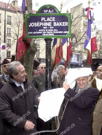 TIBERI BOUILLON The eldest son of late singer Josephine Baker, Akio Bouillon, right, is partly covered by a veil as Paris Mayor Jean Tiberi, left, looks, during the inauguration of the Place Josephine Baker in Paris