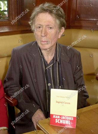 "SCHUHL French writer Jean-Jacques Schuhl poses for photographers in the Cafe de Flore in Paris, moments after he was awarded the Prix Goncourt, France's most prestigious literary award, for his book ""Ingrid Caven"