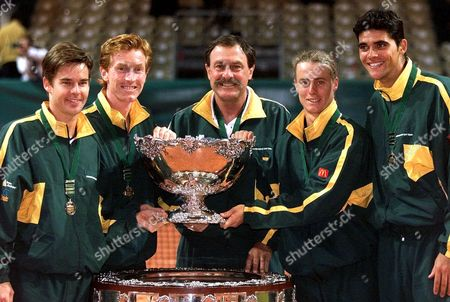 Australian Davis cup team, left to right, Todd Woodbridge, Mark Woodforde, captain John Newcombe, Lleyton Hewitt and Mark Philippoussis pose with the Davis Cup trophy after winning the Davis Cup final against French team, Sunday Dec. 5,1999, in Nice French riviera