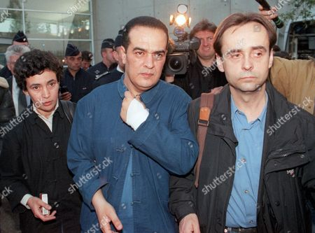 ZOGHLAMI Tunisian journalist Taoufik Ben Brik, center, Reporters Without Borders Secretary General Robert Menard, right, and Ben Brik's sister Nahjet Zoghlami, left, leave the freight zone building at Roissy-Charles de Gaulle airport, north of Paris, after Ben Brik gave a press conference upon his arrival in France, . Tunisian authorities dropped a judicial investigation against Ben Brik last Wednesday and lifted a travel ban. Ben Brik, 39, has been on hunger strike since April 3rd., to protest alleged government harassment