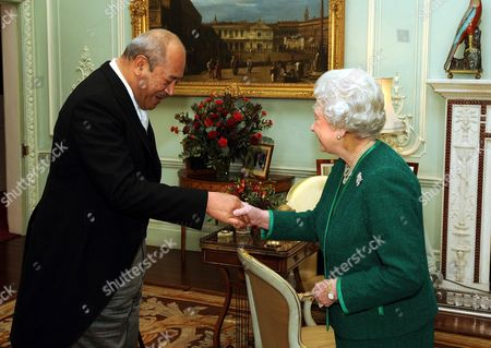 Queen Elizabeth II shakes hands with King George Tupou V of Tonga during a private meeting