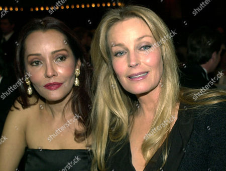 "CARRERA DEREK Actress Barbara Carrera, left, and actress Bo Derek pose for photographers during the ""Opernball"" at the Old Opera in Frankfurt, Germany, Saturday evening, . More than 2.300 guests celebrated the 19. Frankfurt Opernball wich had the slogan ""Viva Europe"