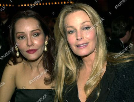 "CARRERA DEREK Actress Barbara Carrera, left, and actress Bo Derek pose for photographers during the ""Opernball"" at the Old Opera in Frankfurt, Germany, Saturday evening"