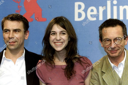 """GAINSBOURG LECONTE TORRETON French director Patrice Leconte and the acters Charlotte Gainsbourg and Philippe Torreton, from right, pose for the media prior to a news conference on their movie """" Felix and Lola"""" at the Berlin film festival """"Berlinale"""" on . """"Felix and Lola"""" is one of 23 movies in the competition"""