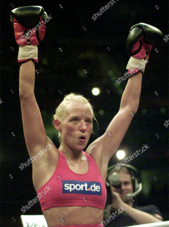 Germany's boxer Daisy Lang celebrates after winning the WIBF World Championship fight against American Brenda Lee Burnside at the Koelnarena, Cologne, Germany, Saturday night