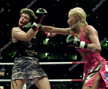 Germany's boxer Daisy Lang, right, punches Brenda Lee Burnside of the U.S.A. during the WIBF World Championship at the Koelnarena, Cologne, Germany, Saturday night, Oct.14, 2000. Lang won the fight on points