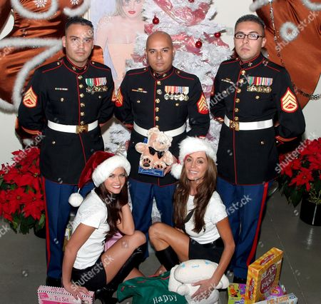Playmates (L to R) Lauren Michelle Hill and Ava Fabian with Marines (L to R) Staff Sgt Isboset Rendon, Sgt Rene Renteria, Staff Sgt Alanis Ricardo