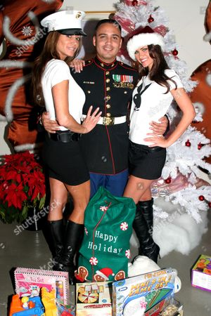 Playmates (L to R) Ava Fabian and Lauren Michelle Hill with Staff Sgt Isboset Rendon