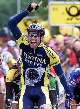"""Stock Image of WUEST German Marcel Wuest of the French Festina Team celebrates after winning the sixth stage of the """"Deutschland Tour"""", Cycling Tour of Germany, in Herzogenaurach, on"""