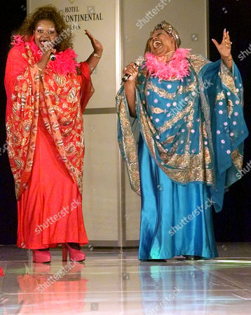 """WEATHER GIRLS The singers """" Weather Girls """" wear robes of Harald Gloeckler as they perform """"It's raining men"""" on the catwalk of the Intercontinental Hotel in Berlin, . The fashion show """"Pompoes"""" (pompous) displayed the work of the German designer Harald Gloeckler"""