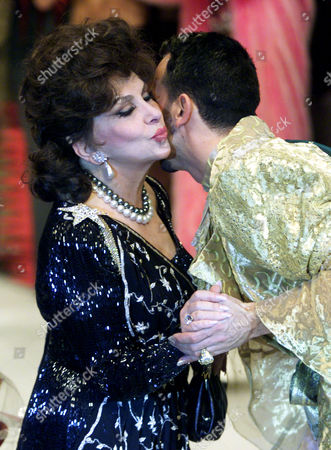 Stock Image of LOLLOBRIGIDA GLOEOECKLER Gina Lollobrigida, left, kisses German star fashion designer Harald Gloeckler after his 'Pompoes Star Courture Show', Saturday evening, in Duesseldorf. It was the opening for Duesseldorf's 'Collection Premiere' fashion show, which lasts until February 10