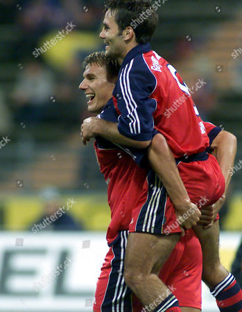 ZICKLER WIESINGER FC Bayern Munich striker Alexander Zickler, left, carries teammate Michael Wiesinger in jubilation after he scored a goal during the match FC Bayern Munich vs. Manchester United at the Munich, Germany, Olympic stadium, on occasion of the 100th anniversary of Munich's club FC Bayern