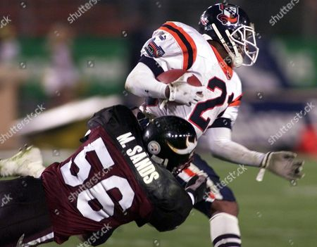 WILLIAMS SANDS Runningback Clarence Williams, right, of the Amsterdam Admirals is attacked by Linebacker Mike Sands during the World League Football match between Duesseldorf Rhein Fire vs. Amsterdam Admirals on in the Duesseldorf Rhein-Stadium. Rhein fire wins the match 24-20 points