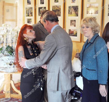 Prince Charles meets Linda Taylor with Camilla, Duchess of Cornwall looking on