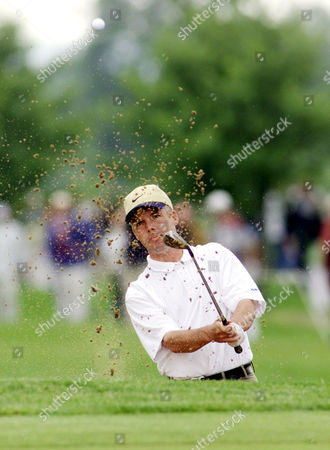 ROBERTSON Golfer Dean Robertson from Scottland hits the ball out off a bunker on the first hole during the third round of the Deutsche Bank SAP Open in St. Leon-Rot, 60 miles (100km) south of Frankfurt, Germany