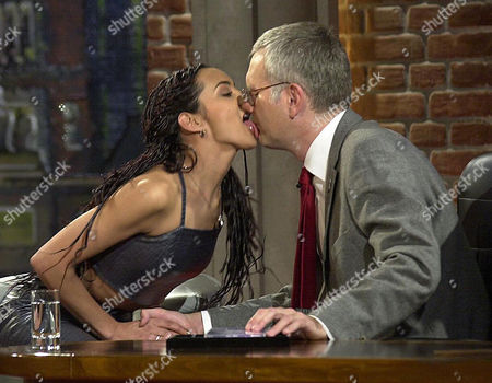 """SCHMIDT GRAHAM British singer Melissa Graham, 25, left, from Coventry licks the face of German TV moderator Harald Schmidt during her appearance in Schmidt's late night """"Harald Schmidt Show"""" in a TV studio in Cologne, western Germany, Wednesday evening, Dec. 20. 2000. Melissa Graham's newest song """"Bullet Proof"""" climbs upwards in the charts"""