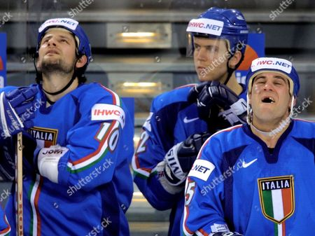 TONI Italy's hockey player Scott Beattie, right, Stefano Margoni, center, and Lino de Toni, react during the group D icehockey World Championships match Canada versus Italy in the Preussag Arena in Hanover, northern Germany, on . Canada won the match 3-1