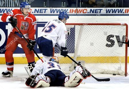 UJCIK BEATTIE CARPANO Czech Republic's player Viktor Ujcik, left, after the 10th goal during the icehockey group E World Championships match Czech Republic vs Italy in Hanover's Preussag Arena, northern Germany, . At center is Italy's Scott Beattie, and keeper Andrea Carpano lies on the ice