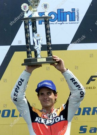 500CC RACE Spanish rider Alex Criville presents his trophy to the crowd as he placed second during the 500cc race of German motor cycling Grand Prix at the Sachsenring circuit . U.S. rider Kenny Roberts junior won the race and Japanese rider Norick Abe placed third