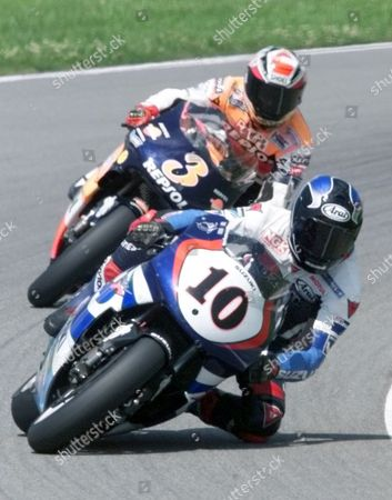 500CC RACE U.S. rider Kenny Roberts junior leads on his Suzuki during the 500cc German motorcycle Grand Prix at the Sachsenring circuit, while Spanish rider Alex Criville follows him. Roberts won the race and Criville placed second