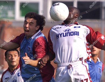YEBOAH OEZKE Hamburg's Anthony Yeboah, right, and Trabzonspor's Okan Oezke jump for the ball during a second leg match of the UI-Cup semifinal of German soccer club Hamburg vs Turkish club Trabzonspor Kuluebue in Luebeck, northern Germany, on . Left Hamburg's Rodolfo Cardoso