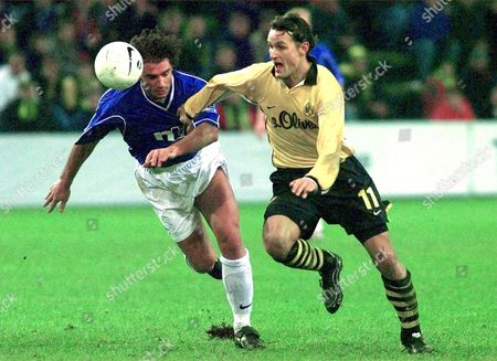 Dortmund's Heiko Herrlich, right, struggles with Lorenzo Amoruso during UEFA Cup match Borussia Dortmund versus Glasgow Rangers at Dortmund's Westfalen stadium,Germany