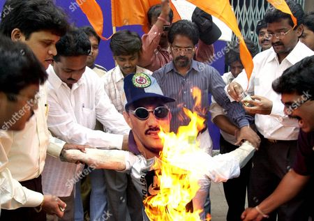 MOHAMMED AZHARUDDIN An effigy of former India cricket captain Mohammed Azharuddin is set ablaze by activists of the Hindu Shiv Sena party in Bombay . Azharuddin was named in a report, released Wednesday by India's Central Bureau of Investigation, for allegedly colluding with bookmakers to fix matches along with team mates Ajay Jadeja and Nayan Mongia. The top Indian law enforcement agency's report also names England's Alec Stewart, Australia's Mark Waugh, Sri Lanka's Arjuna Ranatunga, West Indies' Brian Lara and Pakistan's Salim Malik, among foreign cricketers who were either offered or paid money by bookmakers in the game's biggest scandal