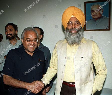 RIndian cricket board President A C Muthiah, left, shakes hands with Indian Sports Minister Sukhdev Singh Dhindsa on in New Delhi. Central Bureau of Investigation, India's top law enforcement agency, Wednesday released a report naming Indians Mohammed Azharuddin, Ajay Jadeja, Nayan Mongia and England's Alec Stewart, Australia's Mark Waugh, Sri Lanka's Arjuna Ranatunga, West Indies' Brian Lara and Pakistan's Salim Malik, among foreign cricketers who were allegedly either offered or paid money bybookmakers in the game's biggest scandal