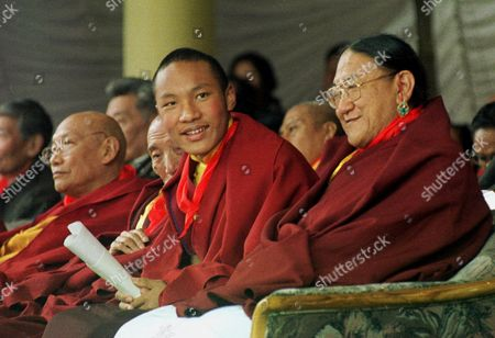 Stock Picture of KARMAPA SAKYA The 17th Karmapa Lama, born Urgyen Trinley Dorje, 14, center, smiles during a ceremony to mark the 60th anniversary of the Dalai Lama's enthronement in Dharmsala, India . At right is high Lama Kyabjey Sakya Trizen, the holder of the Sakya Throne