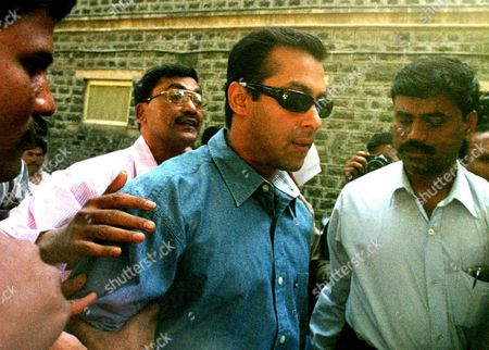 KHAN Plainclothed policemen lead Indian movie star Salman Khan (center and sporting dark sunglasses) to an interrogation cell for questioning in Bombay . Khan was questioned by the police for acting in a film 'Chori Chori Chupke Chupke', (Secretly, Quietly) which police suspect was financed by the mafia. Nadeem Rizvi (unseen) producer of the same Hindi film, was arrested Wednesday for extortion and links to the mafia, and for allegedly attempting to murder another film producer Rakesh Roshan in January. The Bombay film industry popularly known as Bollywood, produces the largest number of movies worldwide