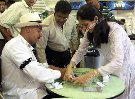 LOU BEGA Lou Bega signs autographs for his fans while announcing his Indian tour in Bombay . Bega, 'Mambo No. 5' fame is the latest singing sensation to hit the international market. He will perform in cities across the country beginning with a show in Bombay Tuesday