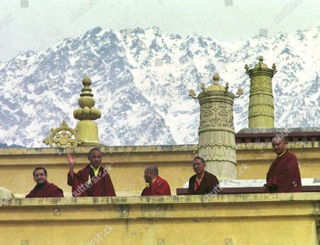 KARMAPA LAMA The 17th Karmapa, Urgyen Trinley Dorje, waves to visitors from atop the Gyuto Ramoche Monastery with the Himalayas as a backdrop near Dharmsala, India . The Karmapa escaped from Chinese occupied Tibet in January and has been living at the monastery since. In an audience on Friday on the eve of the Tibetan New Year, the Karmapa said that Tibetan Buddhists need freedom in order to practice their religion