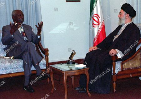 TEHRAN Leader of the Islamic Revolution of Iran Ayatollah Seyyed Ali Khamenei, right, speaks with visiting Kenyan President, Daniel Arap Moi, left, . Arap Moi arrived in Tehran Tuesday for a 3-day official visit and was greeted by President Seyyed Mohammad Khatami at Ebrat palace in north of Tehran