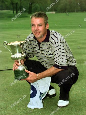 DEAN ROBERTSON Scotland's Dean Robertson holds the trophy of the Golf Italian Open for the first European PGA tour title of his career in Turin . Robertson carded a final-round 68 to move to 17-under-par for the tournament