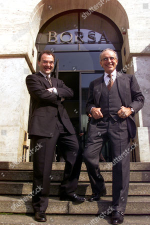 Silvio Scaglia, left, and Francesco Micheli pose in front of Milan's stock exchange, as shares of E. Biscom, a cutting-edge Italian company creating just the third unified broadband network in the world, were traded for the first day. After being suspended for excessive gains at EUR230, over 40% above issue price of EUR160, E.Biscom shares later bounced back to EUR202
