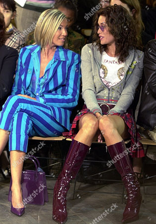 CASALEGNO Italian showgirls Federica Panicucci, at left, and Elenoire Casalegno chat prior to the D&G's Spring-Summer fashion collection in Milan, Italy
