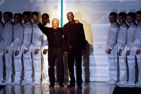 ARMANI JACKSON Italian fashion designer Giorgio Armani, left, and U.S. actor Samuel Jackson acknowledge the audience at the end of the Armani Fall/Winter 2000/2001 men's collection presented in Milan, Italy
